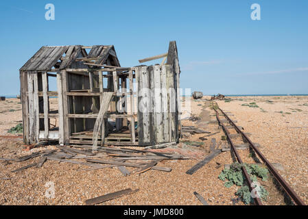 Wooden house and boat falling into ruins - Stock Photo