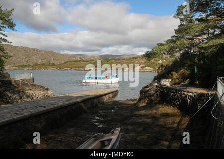 Passenger ferry leaving Garnish Island in Bantry Bay, West Cork, Ireland. - Stock Photo