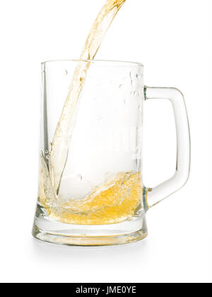 Light golden beer pouring into empty glass pint. Isolated on white, clipping path included - Stock Photo