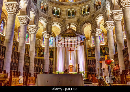 Sainte-Anne-de-Beaupre, Canada - June 2, 2017: Inside Basilica of Sainte Anne de Beaupre with altar and cross - Stock Photo