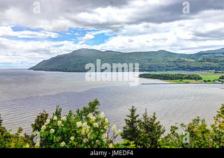 Baie-Saint-Paul in Quebec, Canada cityscape or skyline with mountains on coast and Saint Lawrence river - Stock Photo