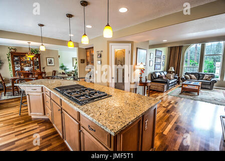 Spacious luxury home with large granite top center island kitchen and open floor plan and great room with large - Stock Photo