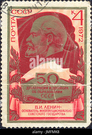 SOVIET UNION - 1972: Postage stamp printed in Soviet Union shows portrait of Lenin - 50 years of USSR declaration. - Stock Photo