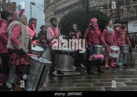 Circus performers drumming in public - Stock Photo