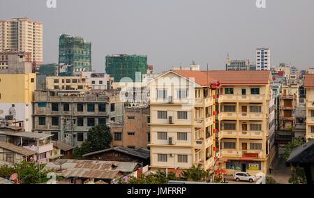 Mandalay, Myanmar - Feb 22, 2016. Buildings located at downtown in Mandalay, Myanmar. Mandalay is the second-largest - Stock Photo