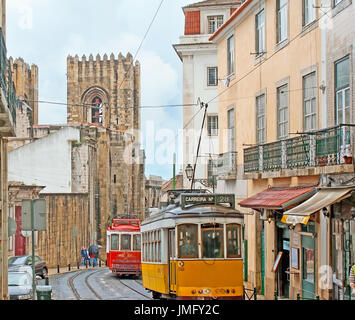 LISBON, PORTUGAL - MAY 2, 2012: The colorful retro trams ride along the Santo Antonio da Se street with a view on - Stock Photo