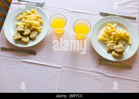 Chicken nuggets and chips or French fries dinner for two  Model Release: No.  Property Release: No. - Stock Photo
