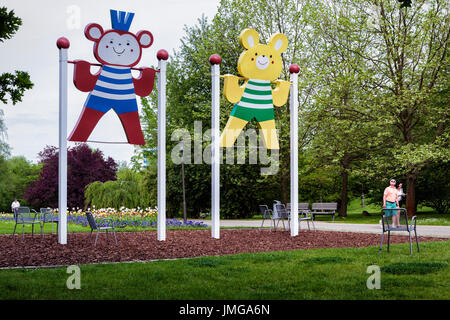 Berlin,Marzahn. Gardens of the World botanic garden,Gärten der Welt, amusing swings, Teddy bear cut-outs in Striped - Stock Photo