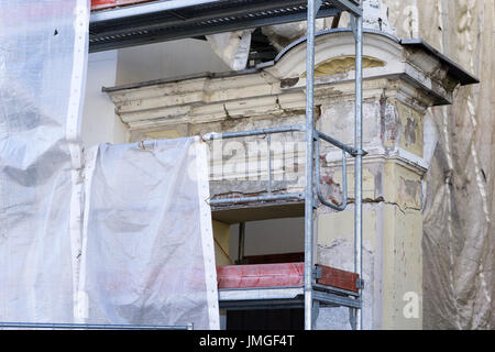 Renovated Building with Scarfold covered with material - Stock Photo
