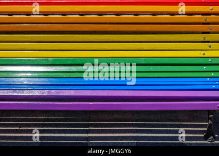 Bench painted with rainbow colors - Stock Photo