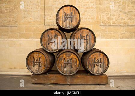 Set of six stacked wood wine barrels outside of Bodegas López de Heredia Viña Tondonia winery (Haro, La Rioja, Spain) - Stock Photo