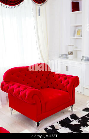 Red classical armchair and white curtains in interior - Stock Photo