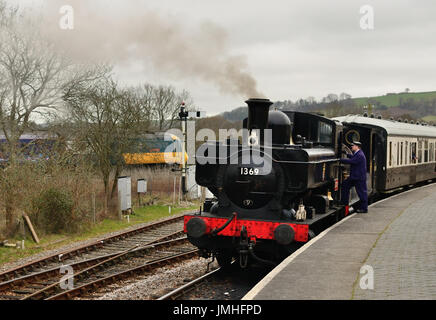 GWR pannier tank No 1369 and Beattie well tank No 30587 wait to leave Totnes Riverside station as an Inter City - Stock Photo