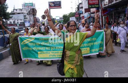 Amra Bangali supporters during a protest demanded the arrest of Gorkha Janamukti Morcha leader Bimal Gurung on July - Stock Photo