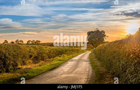A warm sunset follows the end of a typical a summer's day in the Lincolnshire countryside, near the small village - Stock Photo
