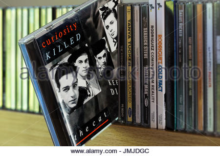 Keep Your Distance, Curiosity Killed the Cat 1987 debut CD pulled out from among other CD's on a shelf, Dorset, - Stock Photo