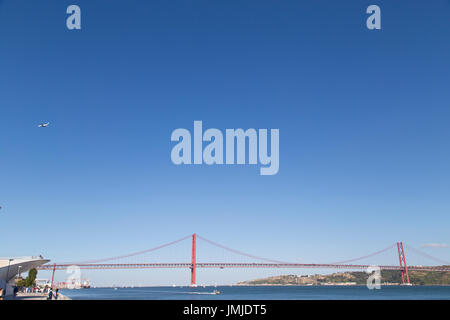 25 de Abril Bridge is a suspension bridge in Lisbon Portugal - Stock Photo