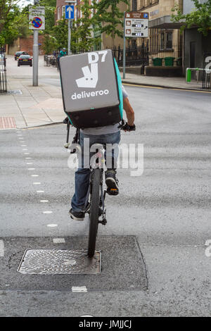Deliveroo cyclist or rider, Nottingham, England, UK - Stock Photo