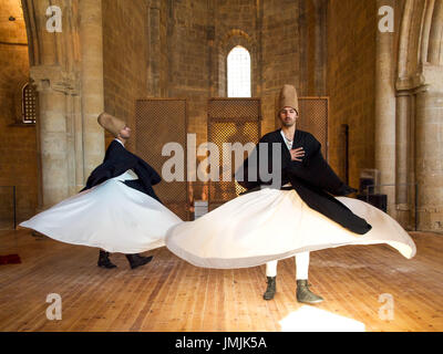 Whirling Dervishes in Ancient Church Turned Mosque in Cyprus - Stock Photo
