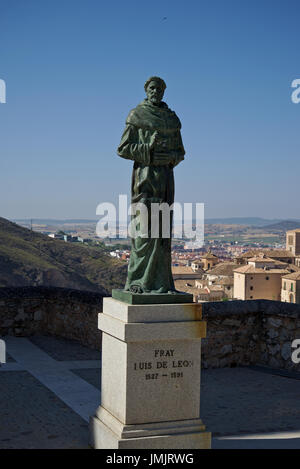 Statue of Fray Luis de Leon made in bronze by sculptor Javier Barrios with the city of Cuenca (Castilla La Mancha, - Stock Photo
