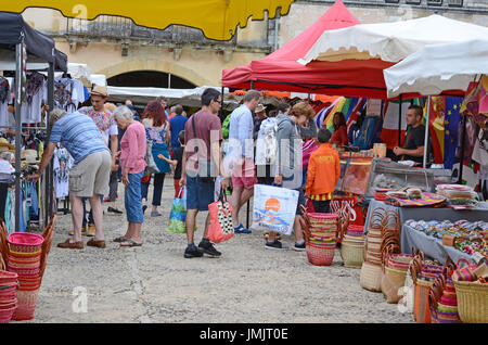 Market day in the French town of Monpazier in the Dordogne region - Stock Photo