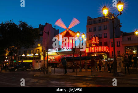 The cabaret famous Moulin Rouge at night,Montmartre area, Paris , France. - Stock Photo