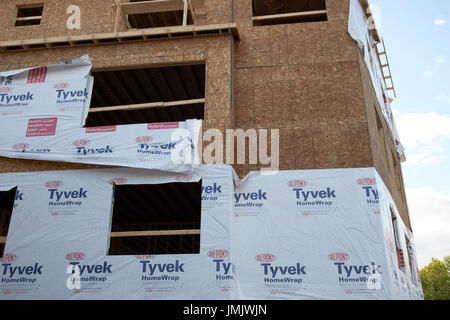 tyvek homewrap on new build apartment buildings under construction Boston USA - Stock Photo