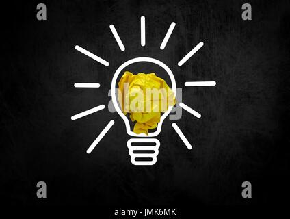 Digital composite of light bulb with crumpled paper ball - Stock Photo