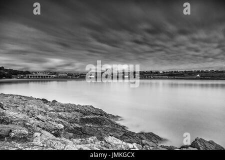 A two minute exposure over Whitmore Bay, Barry Island, Barry in Wales, United Kingdom. - Stock Photo
