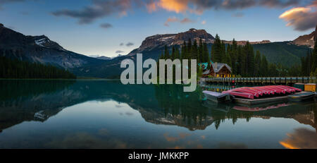 Canoes on beautiful Emerald Lake with lake lodge and restaurant in the background at sunset, Yoho National Park, - Stock Photo