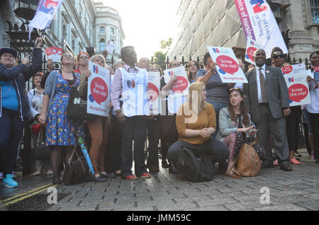 Whitehall, London, UK. 27th July, 2017. Royal college of nursing held a scrap the pay cap rally, coupled with burserie - Stock Photo