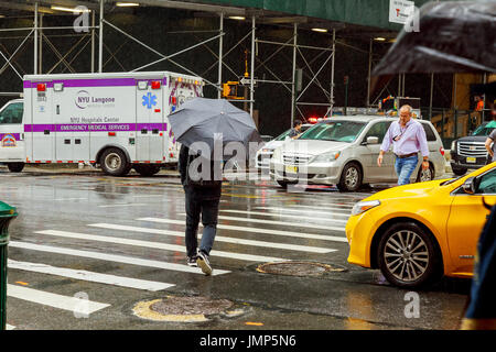 New York, NY - July, 10: People walk along West 42nd Street in New York. Almost 19 million people live in New York - Stock Photo