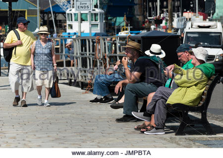 View of people sitting and walking along Poole Quay, Dorset, England UK - Stock Photo