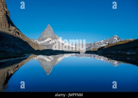 View on Matterhorn reflected in Lake  Riffelsee, Wednesday 24 August 2016, near Zermatt, Switzerland. - Stock Photo