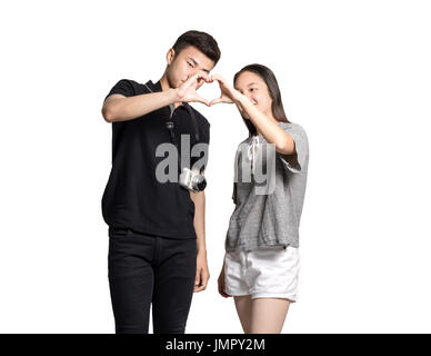 Portrait of young asian couple making the sign of love, Isolated on white background - Stock Photo