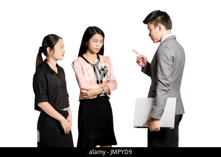 Portrait of three coworkers arguing at work. Young furious man yelling at annoyed stressed woman with pointed finger. - Stock Photo