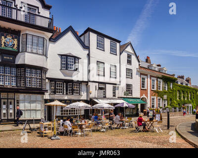 21 June 2017: Exeter, Devon, England, UK - People sitting outside coffee shops in Cathedral Close on a sunny summer - Stock Photo