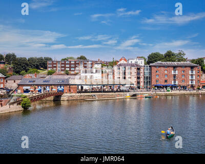 21 June 2017: Exeter, Devon, England, UK - A view across the River Exe to some of the attractions on Exeter Quays. - Stock Photo