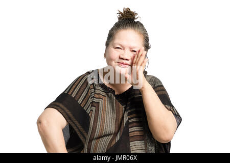 portrait of a mature woman smiling and whispering. Isolated on white background - Stock Photo