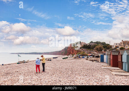 26 June 2017: Budleigh Salterton, East Devon, England, UK - Senior couple on the pebble beach at Budleigh Salterton, - Stock Photo