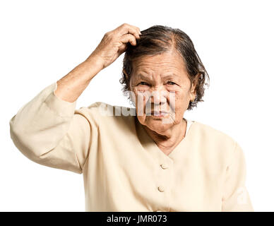 Portrait of a senior woman confused in vintage costume. Isolated on white background - Stock Photo