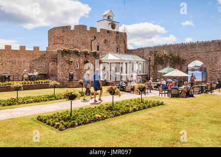 3 July 2017: Sidmouth, Dorset, England, UK - Cafe in Connaught Gardens on a sunny summer day. - Stock Photo
