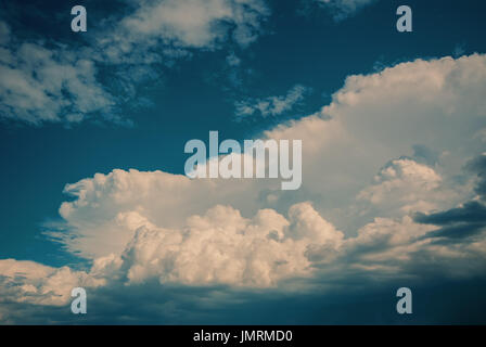 Beautiful white cumulus clouds against the blue sky noon - Stock Photo