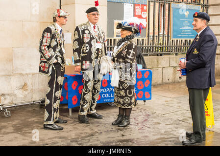 Pearly Kings and a Pearly Queen helping to raise money for the poppy appeal with an ex-serviceman in his beret and - Stock Photo
