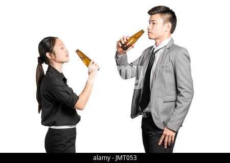 portrait of beautiful young asian business woman and business man drinking bottled beer. Isolated on white background - Stock Photo