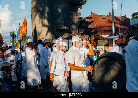 Bali, Indonesia - March 07, 2016: Balinese traditional musicians take part in the ceremonial procession during Balinese - Stock Photo