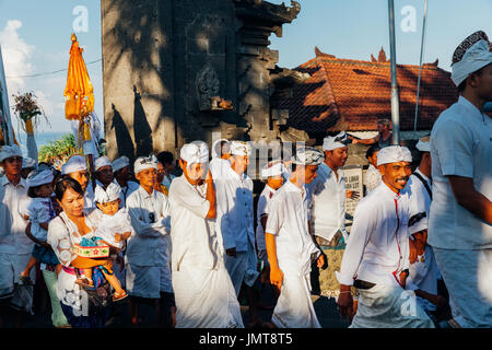 Bali, Indonesia - March 07, 2016: Balinese people in traditional clothes take part in the ceremonial procession - Stock Photo