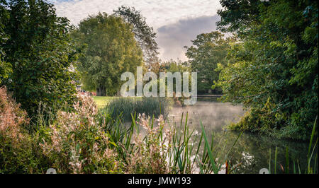 Picturesque views of the historic Lincolnshire town of Stamford taken from the Town Meadows featuring mist rising on the River Welland.