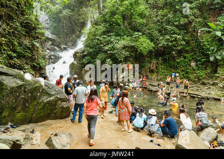Phlio Waterfall, Thailand - July 4, 2015 : People are swimming in canal with fish at Phlio waterfall, Chanthaburi - Stock Photo