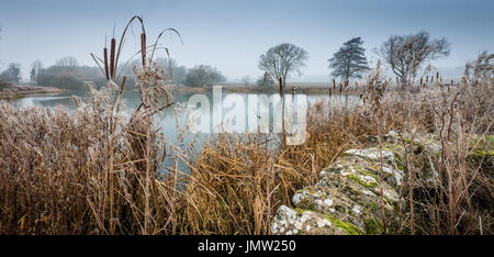 A cold ice lake and frosty morning on the Grimsthorpe Castle Estate near Swinstead, Bourne, Lincolnshire, UK - Stock Photo